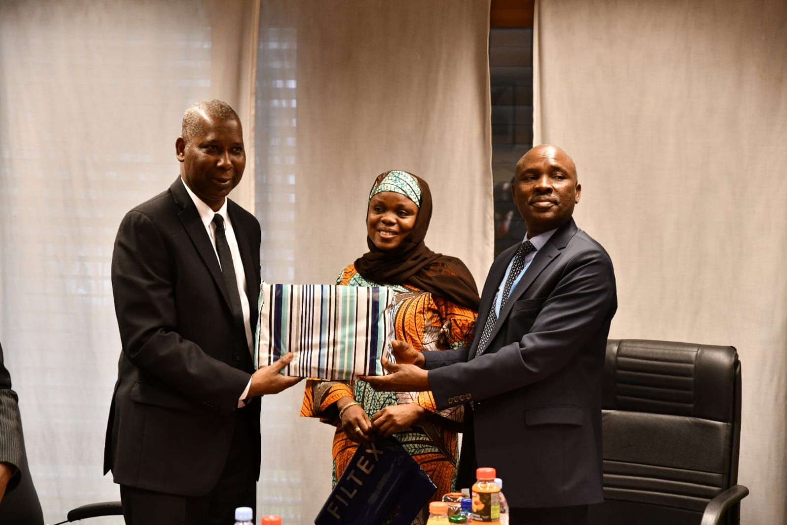 Courtesy Visit of H.E. Tijjani Muhammad Bande, UNGA President to the Mission/H.E. Tijjani M. B. being handed a gift fron the Mission by Charge d'Affaires Mr. Tunde Mustapha and Mrs. Maryam H. Abubakar of the Mission
