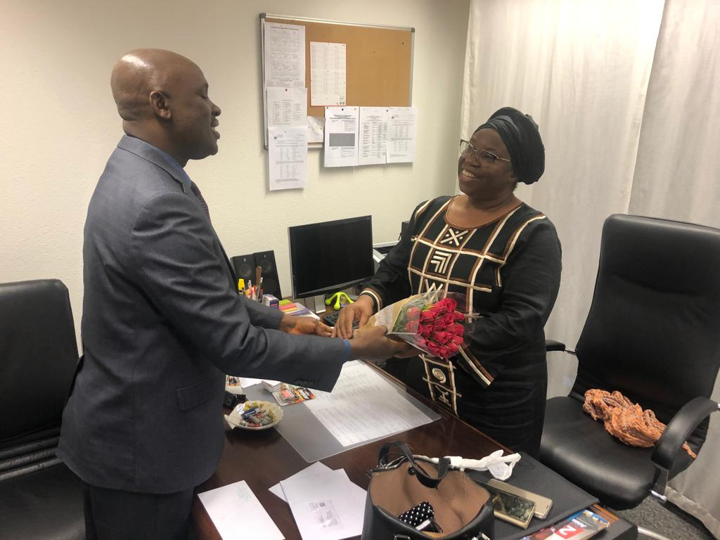 Presentation of gift by Mr. Tunde Mustapha, the CDA a.i. to Mrs Edith Poko who is departing the Mission.
